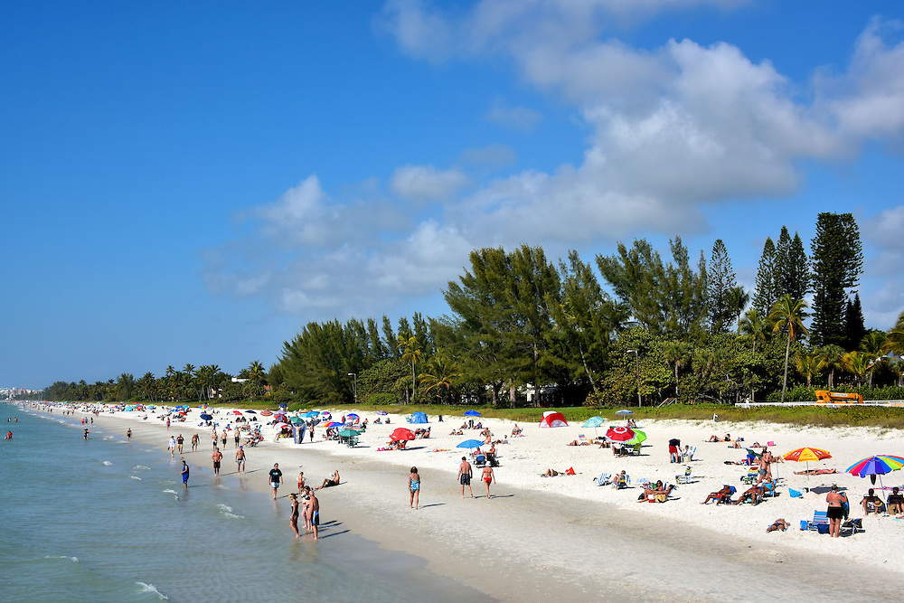 People enjoying sandy beach in naples florida encircle for Warmest florida beaches in december