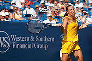 CINCINNATI, OH - AUGUST 16: Jelena Jankovic of Serbia in action during the women's singles final against top-ranked Dinara Safina of Russia in the Western & Southern Financial Group Women's Open on August 16, 2009 at the Lindner Family Tennis Center in Cincinnati, Ohio. Jankovic defeated Safina 6-4, 6-2. (Photo by Joe Robbins)