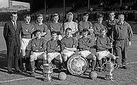 Linfield FC, Belfast, N Ireland, team photo, August 1966. Sitting (left to right): Standing (left to right): Tommy Leishman, Ken Gilliland, Stan Greg, Ronnie White, Iam McFaul, Arthur Thomas, Bryan Hamilton, George Megarry and Jimmy McCune (trainer); Sitting (left to right) Jackie Patterson, Lew Huddlestone, Sammy Hatton, Phil Scott and Billy Ferguson. 196608000018.<br />