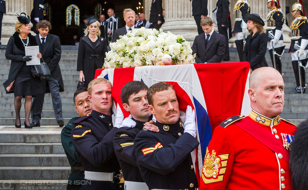 Sir Mark Thatcher, his wife Sarah (top centre), his children Michael and Amanda (right), his twin sister Carol and her boyfriend Marco Grass (left) follow the coffin as they leave St Paul's Cathedral in central London after the funeral service of Baroness Thatcher.