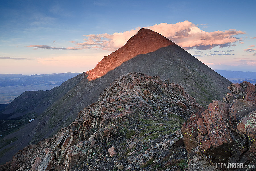 Warm sunset light strike the western face of Humboldt Peak 14,064ft.