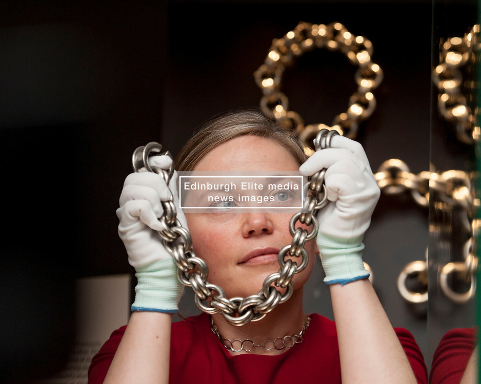 Research Fellow Alice Blackwell with a medieval large silver neck chain, as part of the Silver in Scotland's History exhibition about to go on show at the National Museum of Scotland in Edinburgh.<br /> <br /> © Dave Johnston/ EEm
