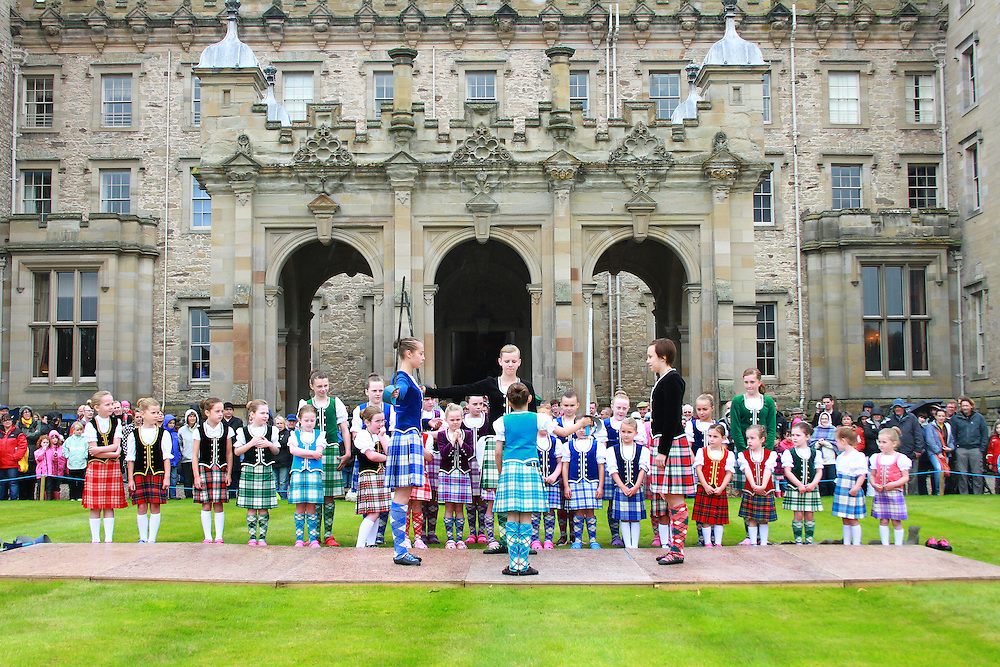 Highland Dancers displaying in front of Floors Castle on Massed Pipe Bands Day