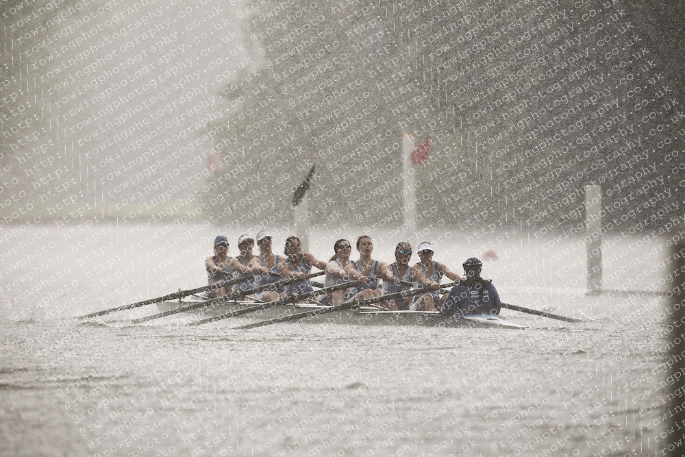 2011.06.17 Henley Womens Regatta. Rowing. Curlew RC v Vesta RC in torrential rain as they race along the famous Henley course.