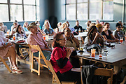 """The audience of the """"Corner Table Podcast"""" recording at Old Sugar Distillery in Madison, Wisconsin, Tuesday, June 18, 2019."""