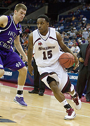 Southern Illinois Salukis guard Tony Young (15) dribbles around Holy Cross Crusaders forward Alex Vander Baan (21).  The #4 seed Southern Illinois Salukis defeated the #13 seed Holy Cross Crusaders 61-51  in the first round of the Men's NCAA Tournament in Columbus, OH on March 16, 2007.