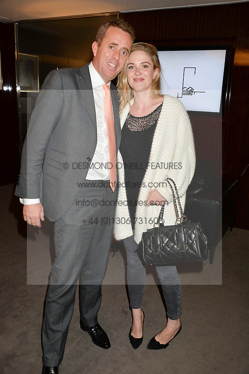 Left to right, NED BARING and LAURA MARSH at a private screening of The Anonymous People in aid of Action on Addiction held at The Bulgari Hotel, 171 Knightsbridge, London on 20th May 2015.