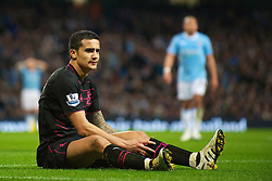 MANCHESTER, ENGLAND - Wednesday, March 24, 2010: Everton's Tim Cahill is left on the floor after a challenge from a Manchester City player during the Premiership match at the City of Manchester Stadium. (Photo by David Rawcliffe/Propaganda)