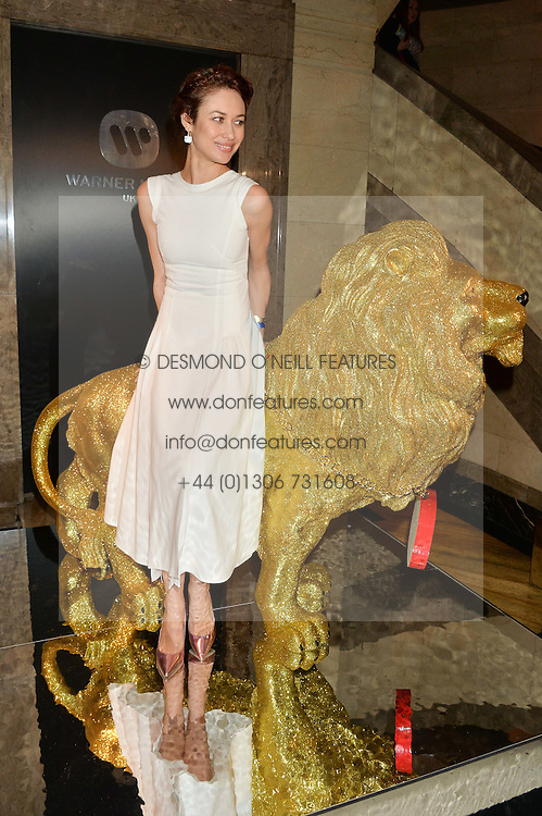 OLGA KURYLENKO at the Warner Music Brit Party held at the Freemason's Hall, 60 Great Queen Street, London on 25th February 2015.