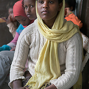 Abeba Beyena, 18, at  Biruh Tesfa, in Addis Ababa. Biruh Tesfa means bright future in Amharic, and is a program for urban adolescent girls at risk of exploitation and abuse. For many girls, going to Biruh Tesfa is their only hope of an education and a respite from their domestic work. ..The program promotes functional literacy, life skills, livelihoods skills, and HIV/reporductive health education through girls' clubs led by adult female mentors. The girls' clubs are held in meeting spaces donated by the kebele (local administration).