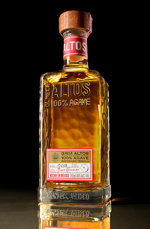 A tall bottle of Altos Tequila in West Palm Beach, Florida.  Beverage Photography by Jeffrey A McDonald