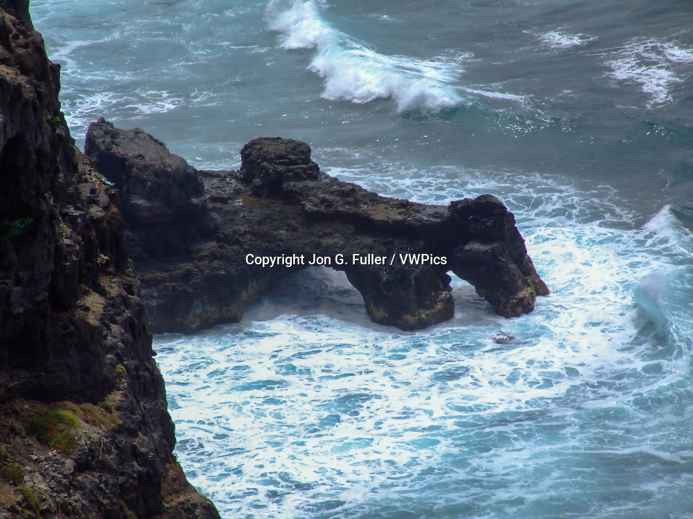 A double sea arch eroded from volcanic basalt on the coast of Santo Antao, Republic of Cabo Verde.