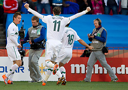 Valter Birsa of Slovenia celebrates with players after he scored during the 2010 FIFA World Cup South Africa Group C match between Slovenia and USA at Ellis Park Stadium on June 18, 2010 in Johannesberg, South Africa. (Photo by Vid Ponikvar / Sportida)