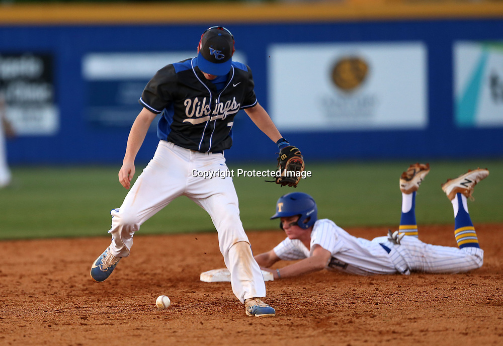 Warren Central second baseman Grayson Shealy drops the catch as Tupelo base runner Gatlin Farrar dives into second in the second inning Thursday night.