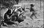 """Beirut, Lebanon May 26th 1985.Sabra and Chatilla refugees camp. Amal militiamen shooting toward palestinian positions during an evacuation of wounded Palestinian fighters, during the """"War of the camps"""", an offensive of the shiite militia Amal  against the remaining PLO palestinian fighters. ..©Herve Merliac"""