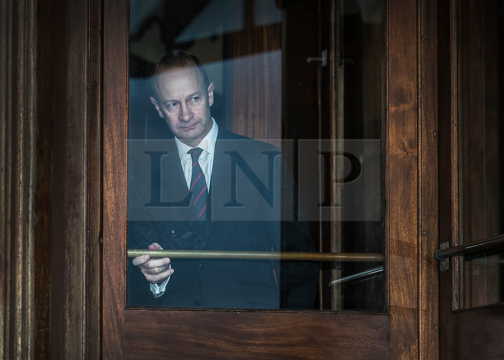 © Licensed to London News Pictures. 22/01/2018. Folkstone, UK. UKIP Leader HENRY BOLTON looks out from the doorway of his hotel as he prepares to gives a statement to the media outside following a series of resignations within the party. Bolton, who has only been leader of UKIP since September 2017, has come under pressure following unfavourable stories in the press about his personal life and the behaviour of his former girlfriend Jo Marney. Photo credit: Peter Macdiarmid/LNP
