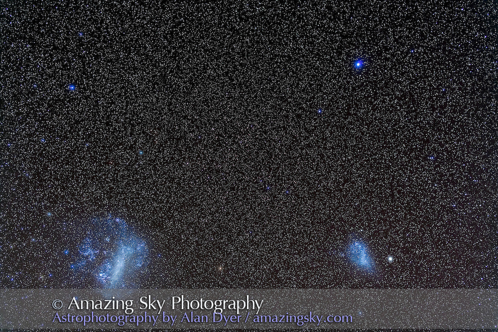 The Large and Small Magellanic Clouds, with Achernar above, shot from Coonabarabran, Australia, December 13, 2012, with a 50mm Sigma lens at f/3.2 and Canon 5D MkII at ISO 800 for a stack of 4 x 4 minute exposures. Some light haze added natural glows around the stars.