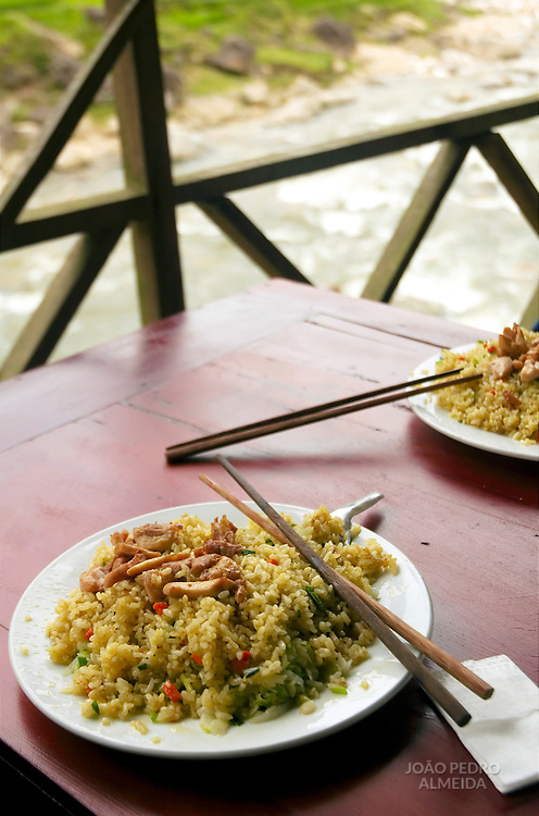 Plate with fried rice and chopstick at the Northern Vietnam