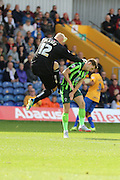 Jake Reeves of AFC Wimbledon feels the force of Brian Jensen (GoalKeeper)  during the Sky Bet League 2 match between Mansfield Town and AFC Wimbledon at the One Call Stadium, Mansfield, England on 5 September 2015. Photo by Stuart Butcher.