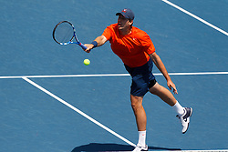 May 24, 2011; Stanford, CA, USA;  Virginia Cavaliers number 1 doubles player Drew Courtney hits a volley against the Southern California Trojans during the finals of the men's team 2011 NCAA Tennis Championships at the Taube Tennis Center.