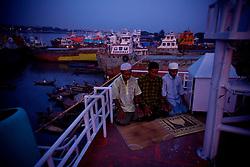 Labors pray in a ship yard in Dhaka, Bangladesh.