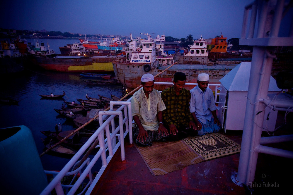 Labors pray in a ship yard in Dhaka, Bangladesh.