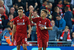 BRITAIN-LIVERPOOL-FOOTBALL-CHAMPIONS LEAGUE-LIVERPOOL VS PSG.(180918) -- LIVERPOOL, Sept. 18, 2018  Liverpool's Roberto Firmino (R) celebrates after scoring the winning goal during the UEFA Champions League Group C match between Liverpool and Paris Saint-Germain at Anfield Stadium in Liverpool, Britain on Sept. 18, 2018. Liverpool won 3-2.  FOR EDITORIAL USE ONLY. NOT FOR SALE FOR MARKETING OR ADVERTISING CAMPAIGNS. NO USE WITH UNAUTHORIZED AUDIO, VIDEO, DATA, FIXTURE LISTS, CLUB/LEAGUE LOGOS OR ''LIVE'' SERVICES. ONLINE IN-MATCH USE LIMITED TO 45 IMAGES, NO VIDEO EMULATION. NO USE IN BETTING, GAMES OR SINGLE CLUB/LEAGUE/PLAYER PUBLICATIONS. (Credit Image: © Han Yan/Xinhua via ZUMA Wire)