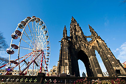 Turning of the large ferris wheel known as the Edinburgh Wheel at the side of the Scott Monument.Edinburgh in the December sunlight..Pic © Michael Schofield.