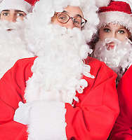 Portrait of people in Santa costume