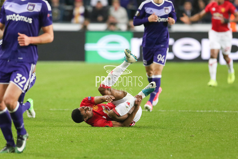 Marcus Rashford Forward of Manchester United on floor injured during the UEFA Europa League Quarter-final, Game 1 match between Anderlecht and Manchester United at Constant Vanden Stock Stadium, Anderlecht, Belgium on 13 April 2017. Photo by Phil Duncan.