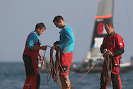 China Team crewmen stow spinnaker sheets after an intense afternoon of America's Cup fleet racing; Valencia, Spain.
