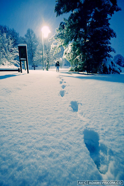 A woman leaves foot prints in the snow during a storm on Nov. 15, 2009 in Denver, CO.