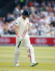 England's Joe Root walks off dejected after getting out to the bowling of Pakistan's Hasan Ali for 4 during day one of the First NatWest Test Series match at Lord's, London.