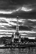 France. Paris cityscape at sunset. the Eiffel tower and  Alexandre III 3 bridge /  la tour eiffel et le Pont Alexandre III .. Before to publish an image of the Eiffel tower lighting you should contact SETE; Mr Dieu at +33144112399 particularly for advertinsing.