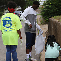 "LIBBY EZELL | BUY AT PHOTOS.DJOURNAL.COM<br /> Kameron Crayton, 13 left, Isaiah Orr, 15, and Cayelin Richardson,11, help pick up trash Saturday in the Park Hill Neighborhood for ""Pick it Up, Tupelo!"""