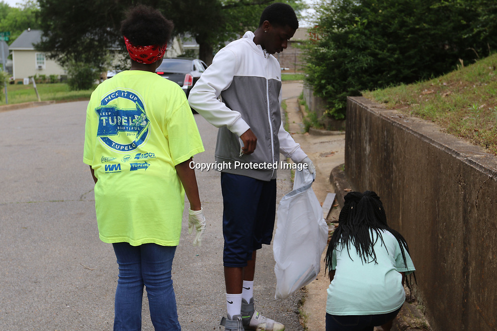 LIBBY EZELL | BUY AT PHOTOS.DJOURNAL.COM<br /> Kameron Crayton, 13 left, Isaiah Orr, 15, and Cayelin Richardson,11, help pick up trash Saturday in the Park Hill Neighborhood for &quot;Pick it Up, Tupelo!&quot;