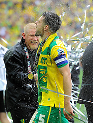 Norwich City captain, Russell Martin is sprayed with champagne - Photo mandatory by-line: Joe Meredith/JMP - Mobile: 07966 386802 - 25/05/2015 - SPORT - Football - London - Wembley Stadium - Middlesbrough v Norwich - Sky Bet Championship - Play-Off Final