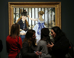 Visitors admire The Railway  at a preview of the new Edouard Manet portraiture exhibition at the Royal Academy of Arts in London, Tuesday, 22nd January 2013.Photo by: Stephen Lock / i-Images