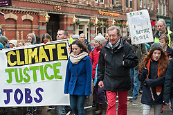 © Licensed to London News Pictures. 29/11/2015. Bristol, UK.  The Mayor of Bristol, GEORGE FERGUSON (in red trousers) joins a protest march through Bristol city centre calling for action against Climate Change, the day before the COP21 Climate Change Conference begins in Paris.  Photo credit : Simon Chapman/LNP
