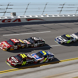 April 17, 2011; Talladega, AL, USA; NASCAR Sprint Cup Series driver Mark Martin (5) drafts Jeff Gordon (24), Kevin Harvick (29) drafts Clint Bowyer (33) and Dale Earnhardt Jr. (88) drafts Jimmie Johnson (48) during the Aarons 499 at Talladega Superspeedway.   Mandatory Credit: Derick E. Hingle