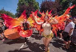 © Licensed to London News Pictures.  07/07/2018; Bristol, UK. Bristol's St Pauls Carnival 50th anniversary, with Amanda from the carnival costume making group. Carnival procession through the streets of St Pauls with many Bristol schools taking part, which has long been a multi-cultural inner city area of Bristol with a a strong Afro-Caribbean community since the Windrush generation. The carnival has not been held for several years due to funding issues but has now secured funding for this year's carnival and beyond. Photo credit: Simon Chapman/LNP