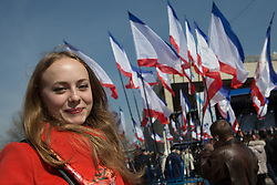 Crimea one day before the referendum. A girl stands in front of crimean flags in a pro Russian rally at Simferopol's Lenin Square. Simferopol, . Saturday, 15th March 2014. Picture by Daniel Leal-Olivas / i-Images