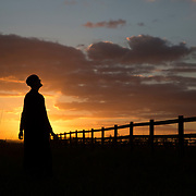 Hermit Sister Rachel Denton views the sunset from a vantage point near St Cuthberts' Hermitage in Lincolnshire, north east Britain September 25, 2015. Sister Rachel Denton has vowed to spend the rest of her life living as a consecrated hermit in the Catholic faith. A hermit is a person who chooses to live alone, with the intention of finding God. Rarely leaving her house she lives a life of prayer and solitude. However, she uses the internet and social media to share her experience and distance her self from physically interacting with society. REUTERS/Neil Hall