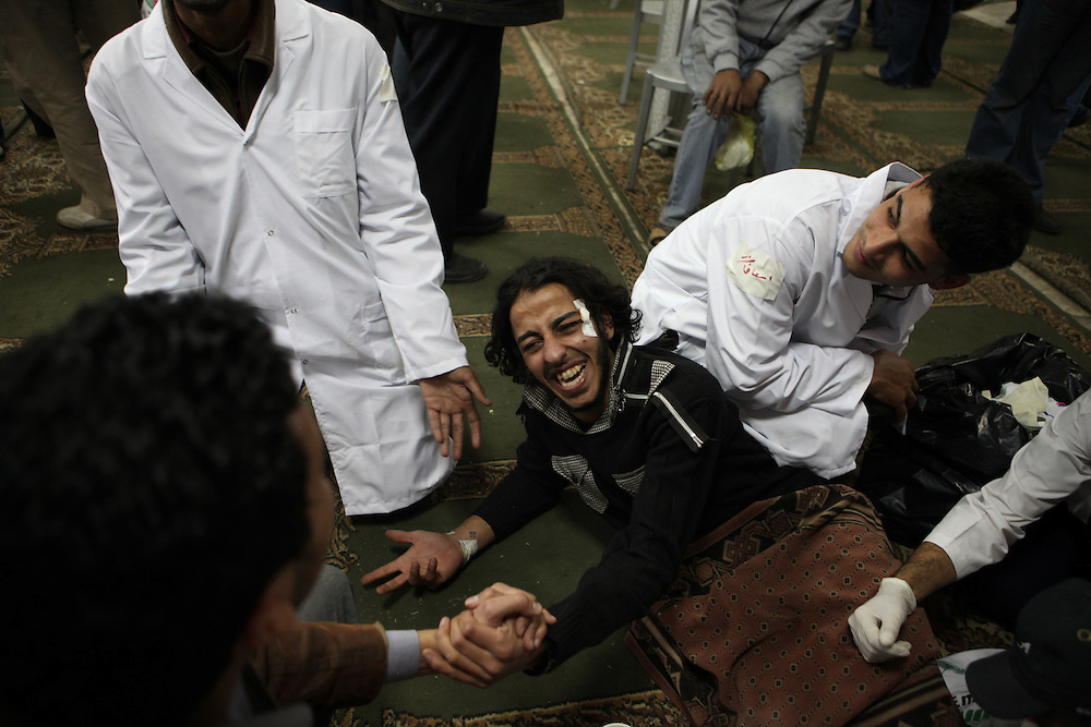 A protester injured by Egyptian police is treated at a makeshift hospital at a mosque in downtown Cairo.