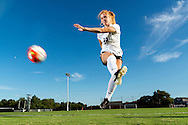 Kim Braddock kicks toward the goal at the K-State Soccer Complex during a media day event on August 13, 2016.