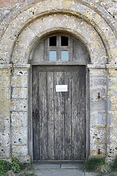 Covid 19 - Chapel closed due to Coronavirus. The sign ends God Bless', St Aldhelm's Head Dorset April 2020