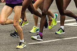 elite women detail of legs running