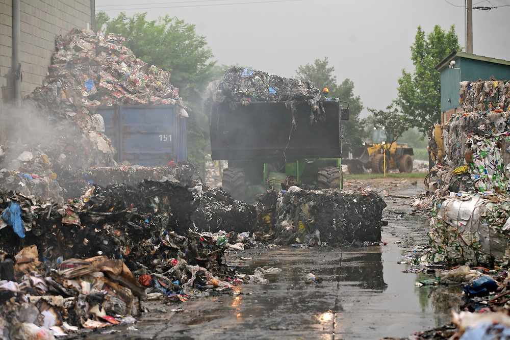 Fire in a factory of garbage recycling. The amount of burned rubish generates many waste polluting. .Celrà. (Catalonia. Spain).