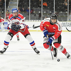 COBOURG, - Dec 18, 2015 -  WJAC Game 11- Team Czech Republic vs Team Switzerland at the 2015 World Junior A Challenge at the Cobourg Community Centre, ON. Philipp Kurashev #23 of Team Switzerland keeps the puck from Matyas Kantner #29 of Team Czech Republic during the first period.<br /> (Photo: Andy Corneau / OJHL Images)