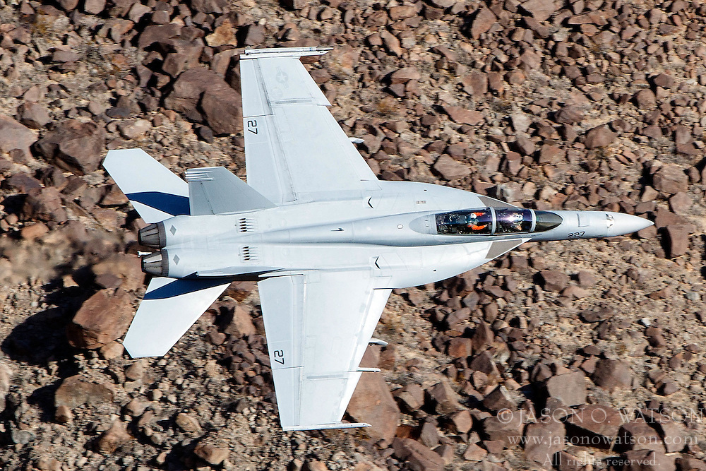 Boeing F/A-18F Super Hornet DD-227 of the US Navy's VX-31 Dust Devils squadron flies low level through the Star Wars Canyon, Jedi Transition, Sidewinder course, Death Valley National Park, California, United States of America